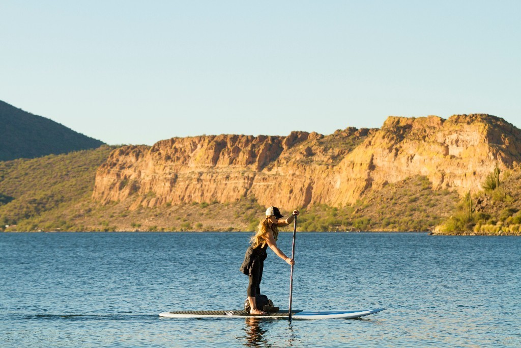 Saguaro lake and Canyon lake paddle board and kayak rentals. Girl paddling on the lake.