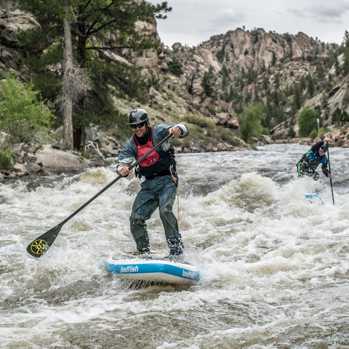 RiverShred paddling down the river on his Badfish SUP