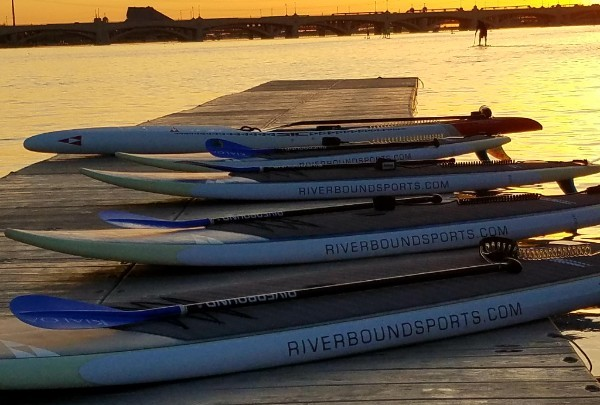 Paddle boards on the dock at Tempe Town lake for the Riverbound Sports Tuesday night sunset paddle.