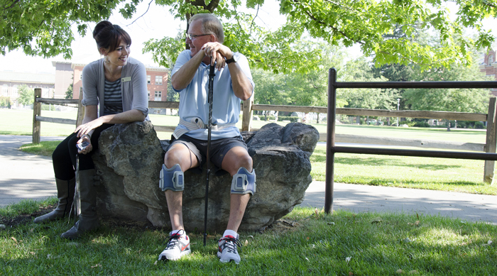 PT student Wendy Lee works with patient Mark Byrn, who is relearning to walk.