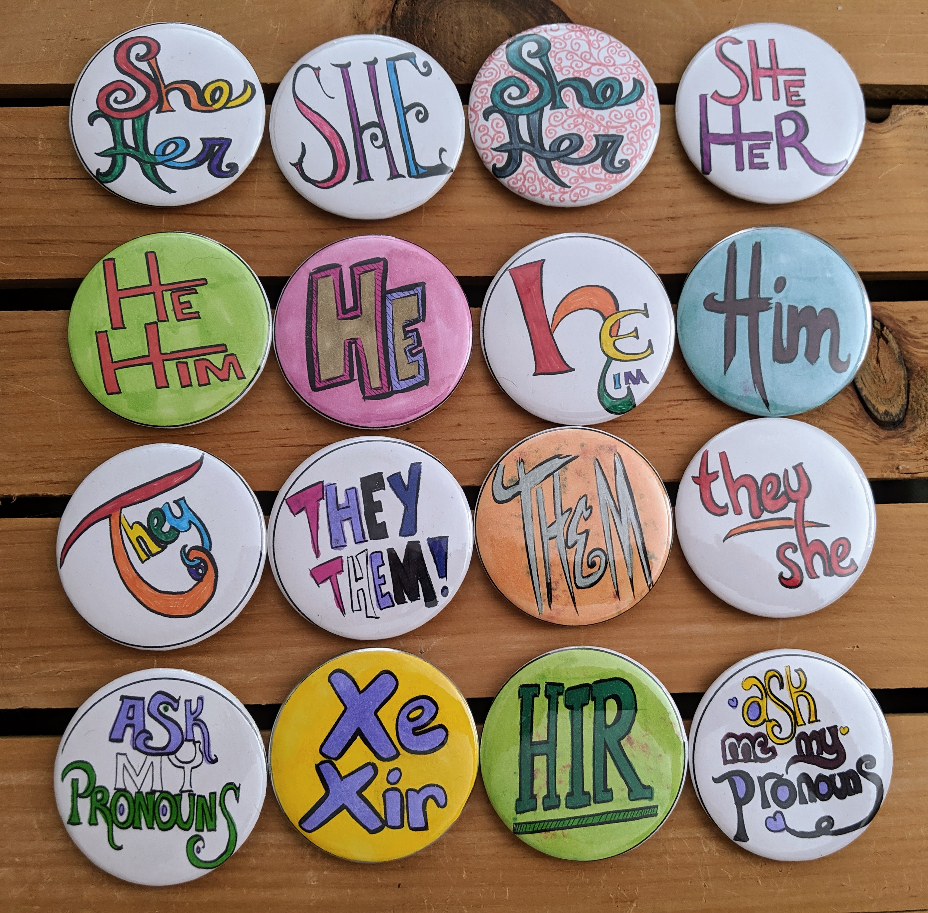 photo of colorful buttons with various pronouns on them