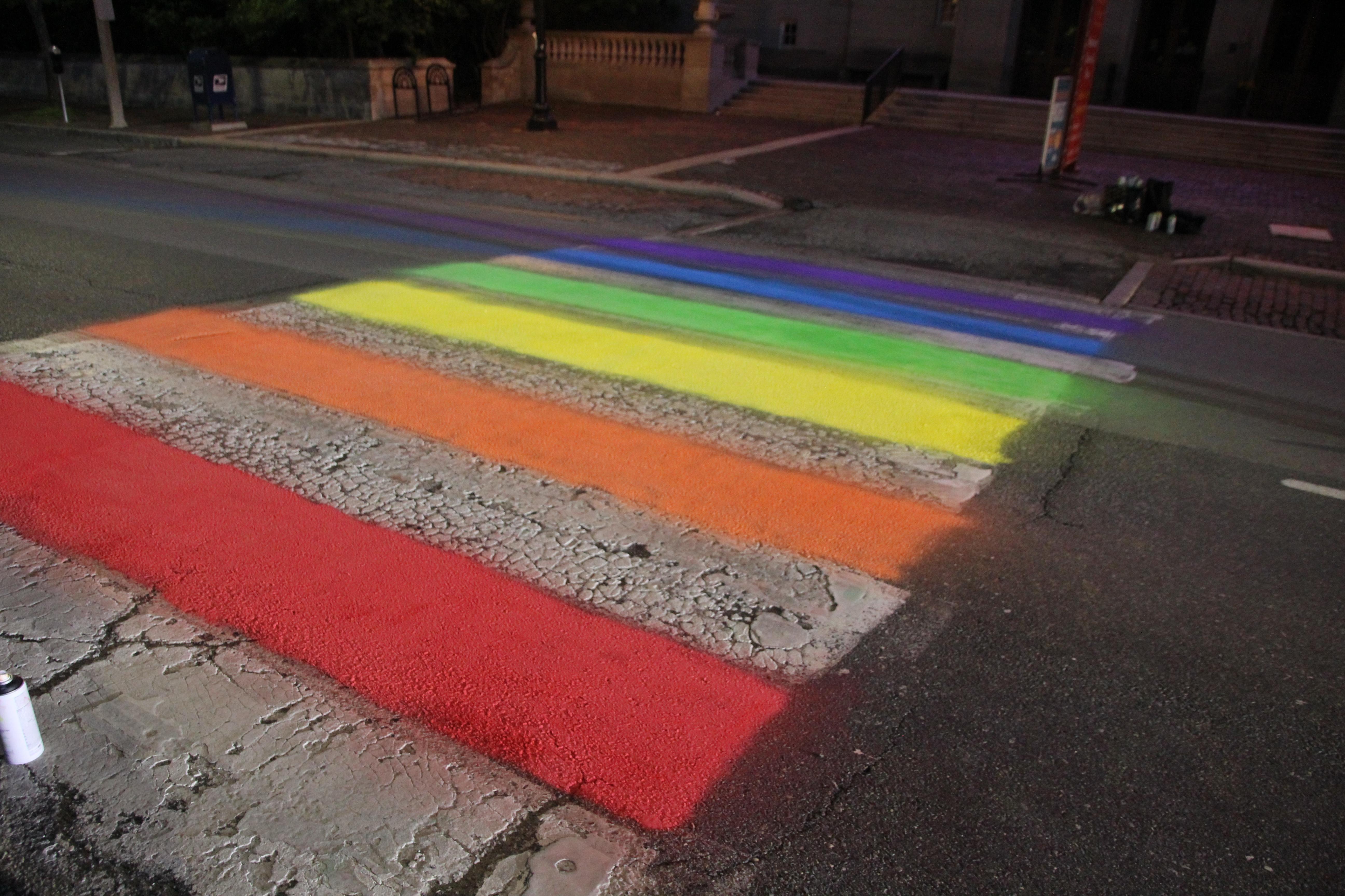 Freshly spraypainted rainbow crosswalk in front of Arlington MA Town Hall