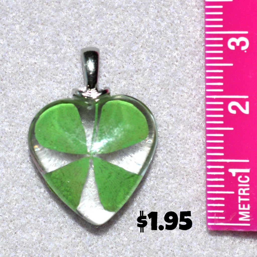 Glass heart with enclosed dried four leaf clover