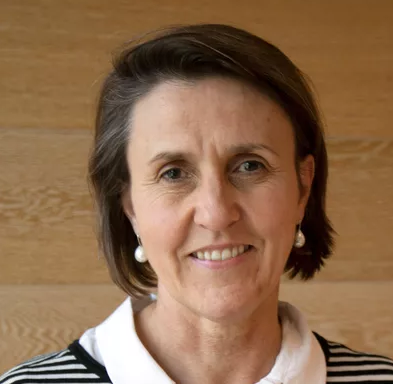 Headshot of Kate Shilling, Chair of Destination Riverina Murray. A woman in business attire against a light wooden background