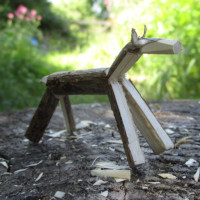 a wooden animal whittled from one piece of hazel