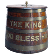 a stout and warmly-patinated english william iv oak ship's rum keg with applied brass lettering 'the king, god bless him' circa 1840