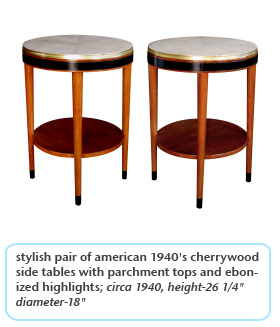 stylish pair of american 1940's cherrywood side tables with parchment tops and ebonized highlights; circa 1940