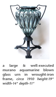 a large & well-executed murano aquamarine blown glass urn in wrought-iron frame, circa 1910