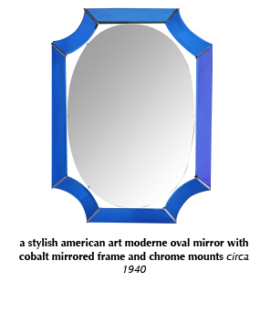 a stylish american art moderne oval mirror with cobalt mirrored frame and chrome mounts circa 1940