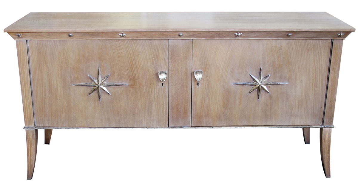 3874- a stylish french mid-century 2-door cerused oak sideboard with silver-leaf star relief motifs 1950's;