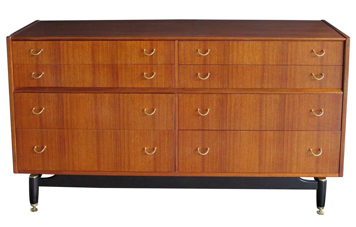 4369 - a stylish english g-plan mid-century 8-drawer teak 'floating' sideboard/buffet/chest with ebonized supports mid-century