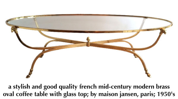 a stylish and good quality french mid-century modern brass oval coffee table with glass top; by maison jansen, paris 1950's