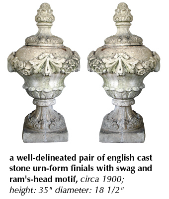 a well-delineated pair of english cast stone urn-form finials with swag and ram's-head motif, circa 1900