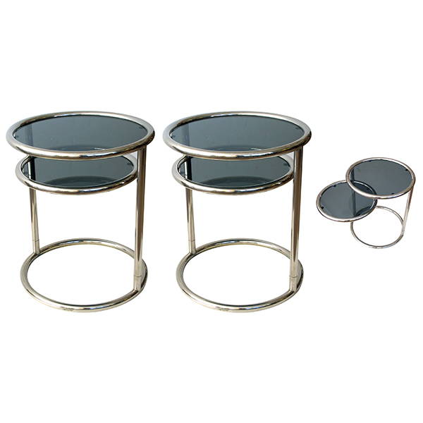 4317 a stylish and fun pair of french 1970's chrome and glass circular side tables with pivoting lower shelf 1970's