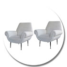 4193 a stylish pair of italian mid-century club chairs with ebonized metal legs; in the style of ico parisi circa 1950