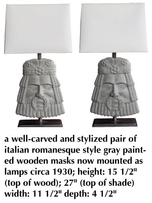 a well-carved and stylized pair of italian romanesque style gray painted wooden masks now mounted as lamps circa 1930