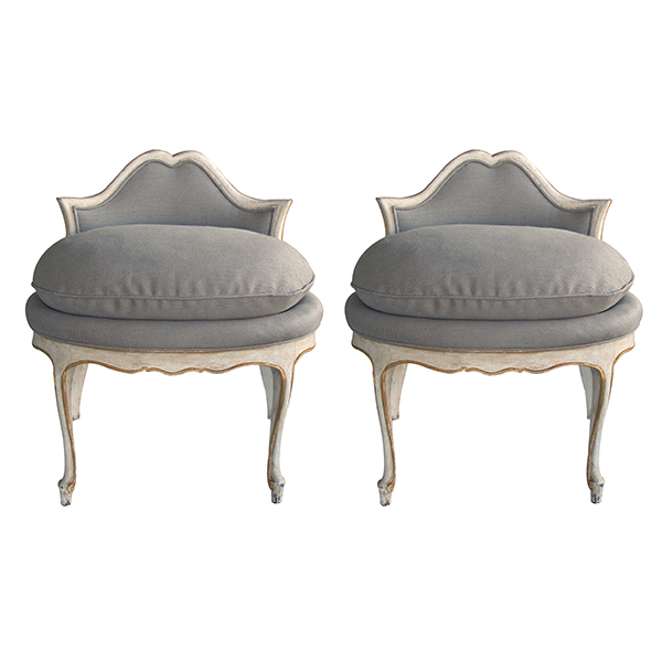 4221 an elegant pair of french louis xv style ivory painted and parcel-gilt low back stools 1950's