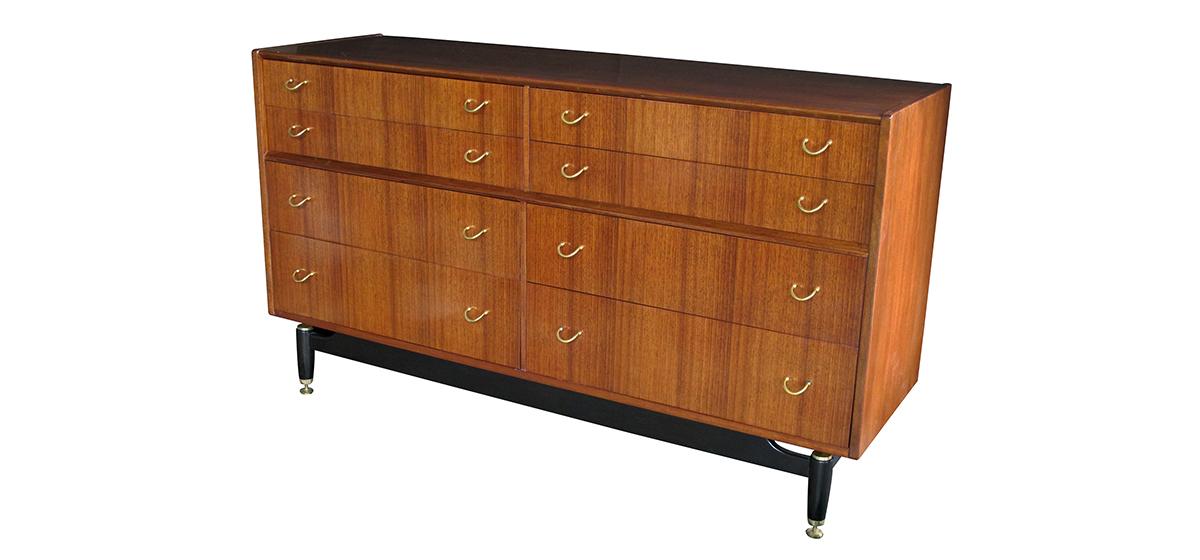 4369 a stylish english g-plan mid-century 8-drawer teak 'floating' sideboard/buffet/chest with ebonized supports mid-century
