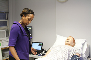 Dr. Kellie Bryant with simulation mannequin