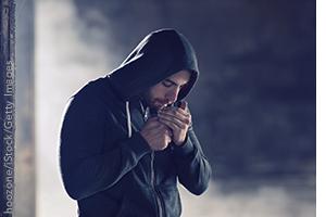 Man in hoodie smoking pot
