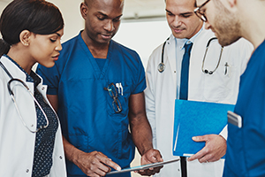 Medical team talking (credit: UberImages/iStock/Getty)