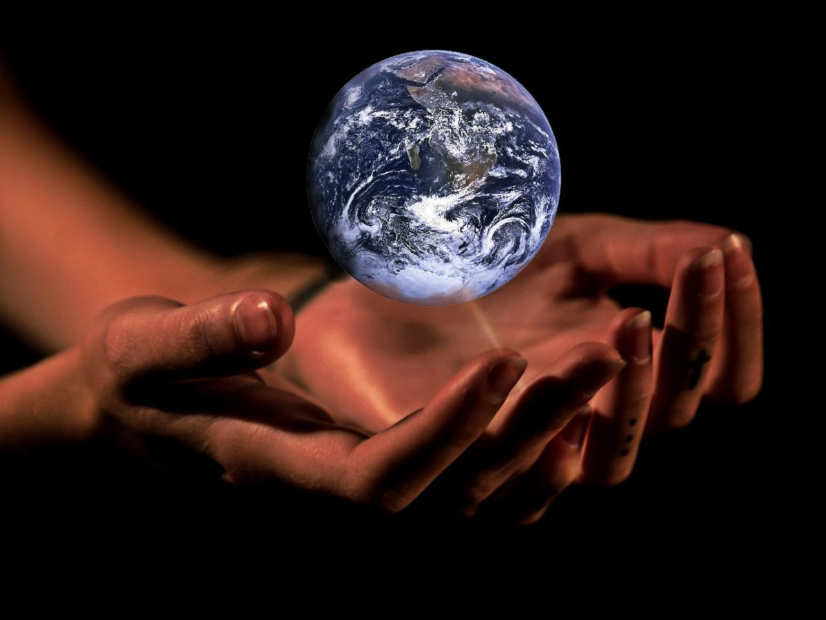 miniature image of the world held in open hands