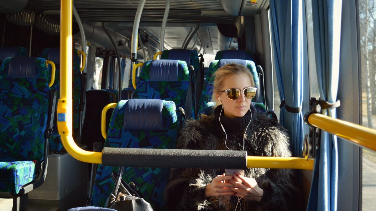 a woman sits on a bus