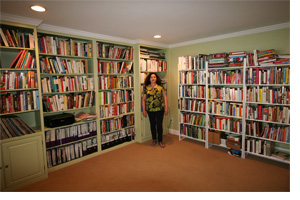 Jane in front of her cookbooks