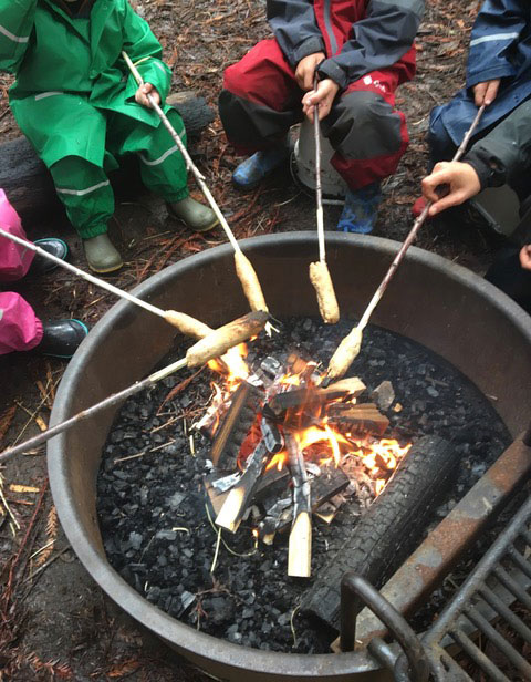 making stick bread over the fire