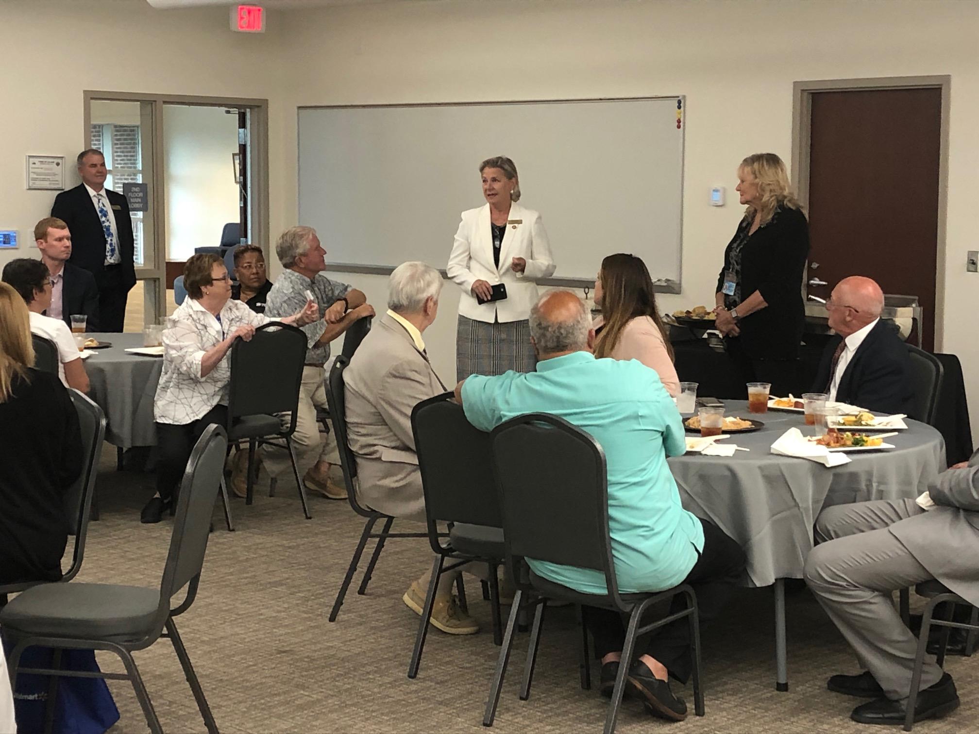 N.C. Representative Deb Butler and Leland Mayor Brenda Bozeman speaking to volunteers during a reception