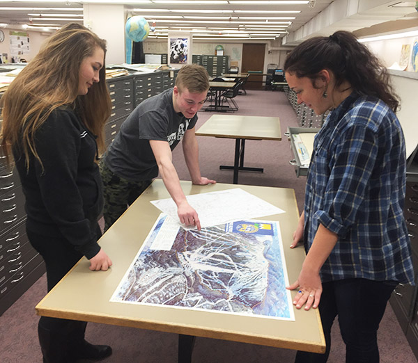 Two Students Using the Map Library