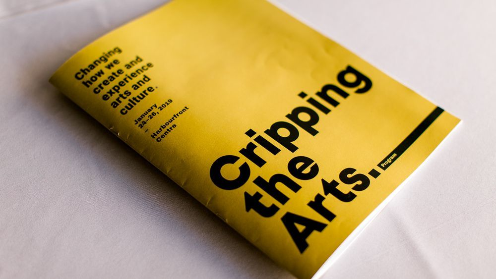 """The Cripping the Arts program, which has a bright yellow cover and black text that says """"Changing how we create and experience arts and culture"""""""