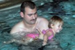 File:US Navy 071119-N-2789G-001 Boatswain's Mate 3rd Class Joshua Hammons, stationed aboard the submarine tender USS Emory S. Land (AS 39), works with his daughter on her swimming during a parent and child swim class at the Bangor F.jpg
