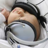Newborn Bruno listens to music with headphones at the Saca hospital in Kosice, Slovakia, Tuesday, May 10, 2011. The hospital uses music therapy to help newborn babies that have to be separated from theirs moms for treatment. (AP Photo/Petr David Josek)