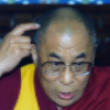 The Dalai Lama, the exiled Tibetan spiritual leader,  points to his head during a news conference, in central London July 16, 1996. The Dalai Lama announced that he was willing to hold talks with China on the future of Tibet without pre-conditions.