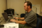 File:FEMA - 32323 - FEMA photographer Mark Wolfe working at a computer in Findlay, OH JFO.jpg