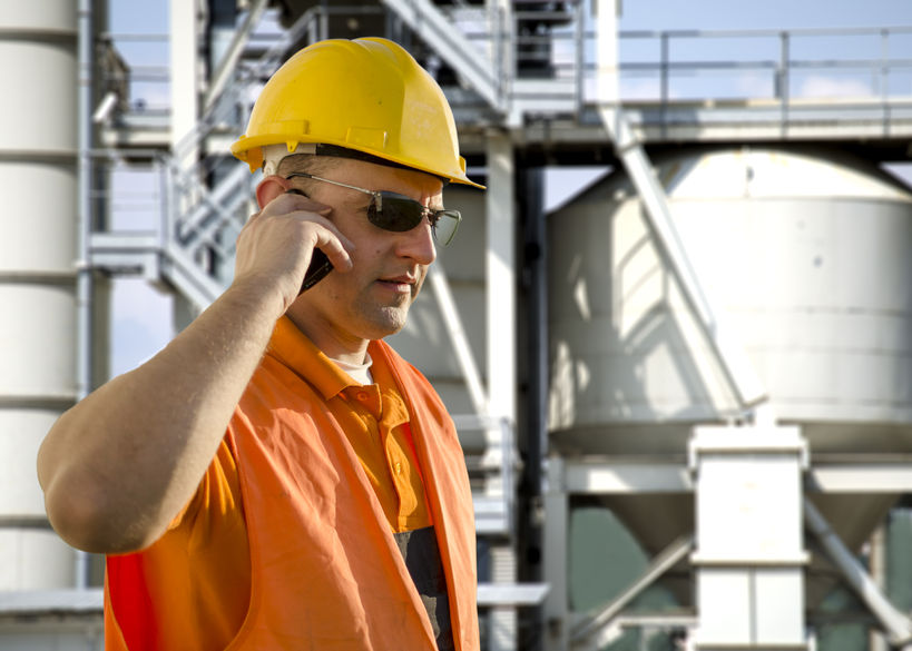 Refinery worker on cell phone