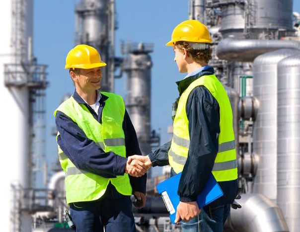 Shaking hands at refinery