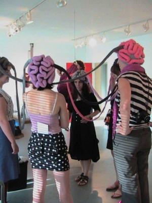 "image credit: Karina Bergmans, ""Thinking Caps"". Harcourt House Staff giving them a go."