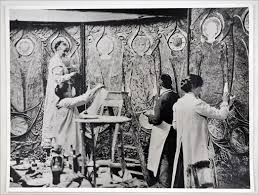 A photo of a group of female artists making an art nouveau wall panel