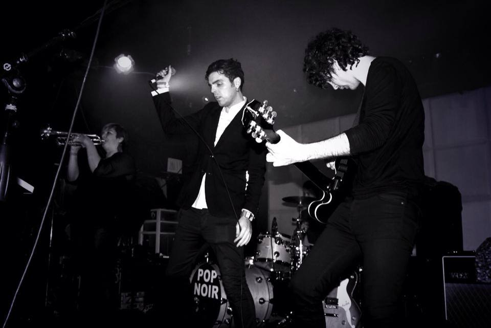 Luke McGarry on stage with Pop Noir