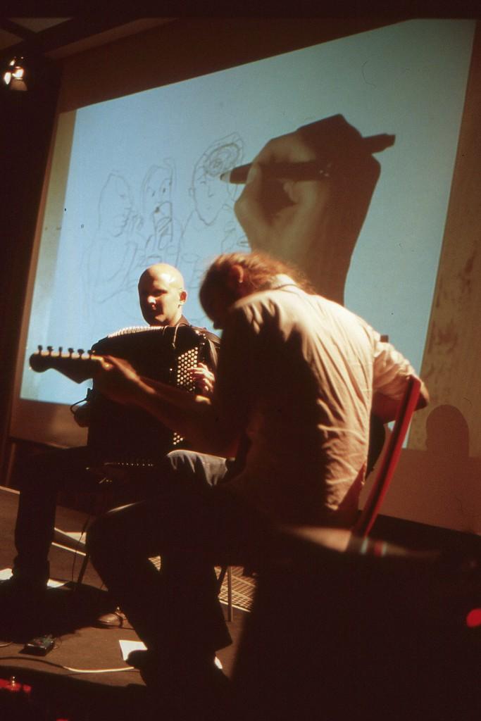 On stage: Ville Ranta, illustration; Aleksi Ranta, guitar; Niko Kumpuvaara, accordion
