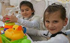 Two Tajik children with disability playing