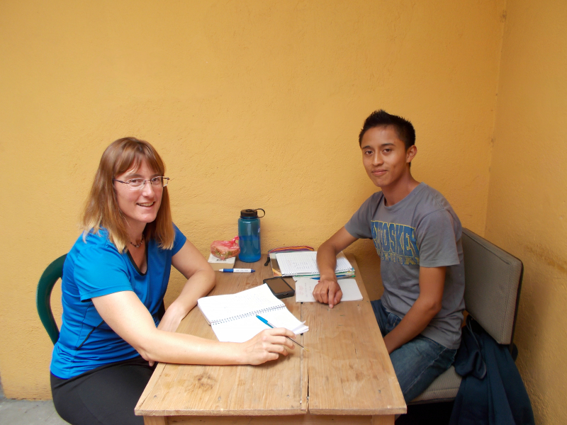 Santos, working with his Spanish student at Pop Wuj.