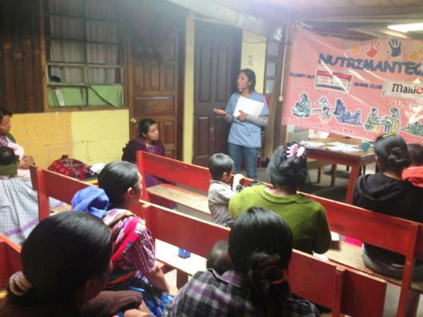 One of the Pop Wuj doctors, Carmen Rosa, explains the Nutrition Program and Nutributter to the new participant families. Photo by Wilder Bautista