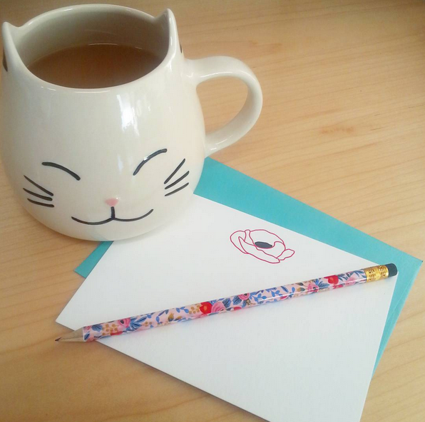 Giant cat mug of tea with letterpress poppy stationery by inviting and a floral pencil from rifle.