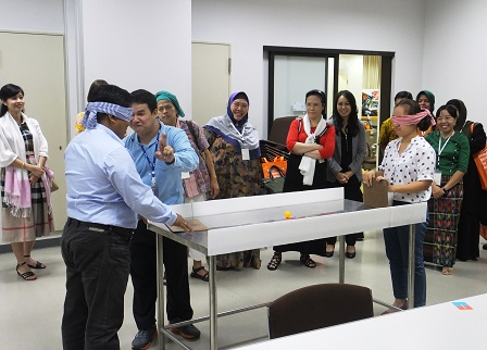 Participants take part in exercises on Disability-Inclusive Sports