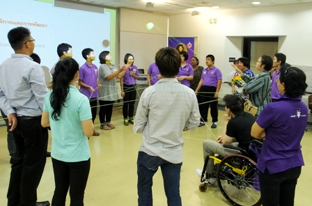 Orientation participants in a group activity about teamwork