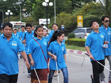 Persons with visual disabilities joining the early morning 'Walk for Health' event