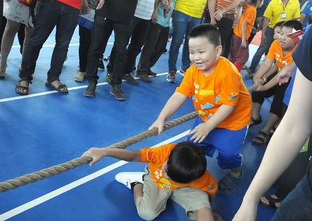 Children with autism having fun at the tug-of-war challenge